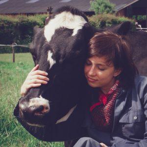 Marta Wronska hugging a cow